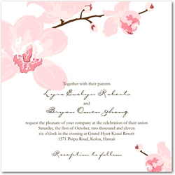 Wedding invitation featuring a soft pink colored orchid flower to the top left and bottom right corners.