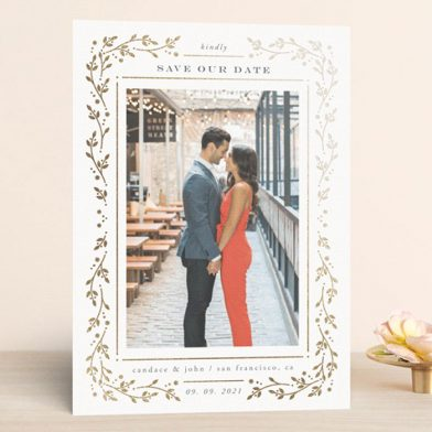 Save the dates from Minted with couple photo and gold foil leaf border.