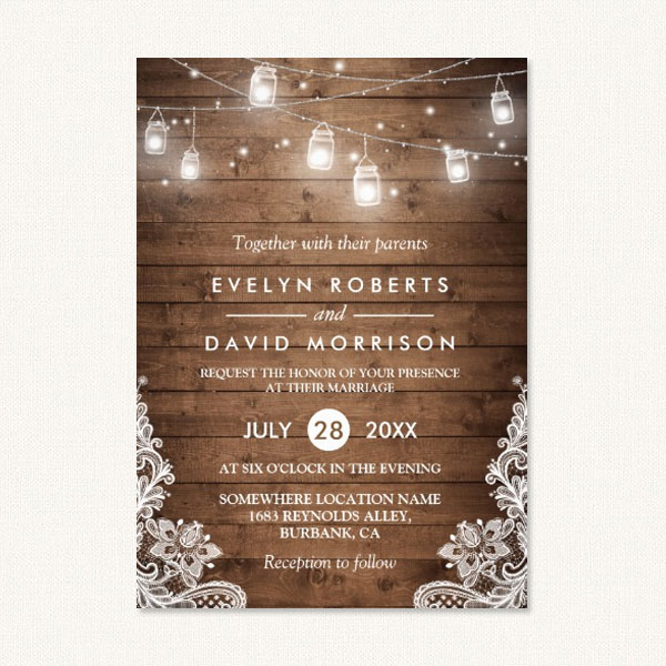 Barn themed wedding invitations with string lights, lace and wood.