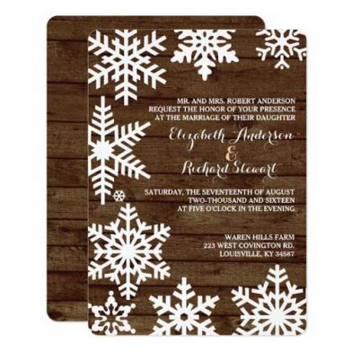 Winter Barn Wedding Invitations With Barn Wood Background and White Snowflakes.