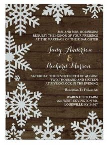 Winter barn wedding invitations on shimmering silver paper stock.