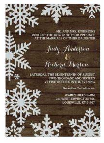 Winter barn wedding invitations on shimmering silver paper stock.