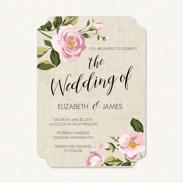 Burlap wedding invites with burlap background and pink flowers.