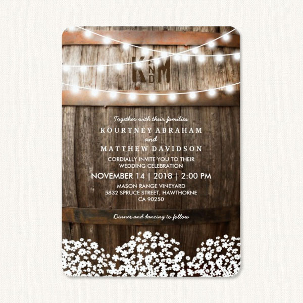 Country style wedding invitations with wood oak barrel, string lights and baby's breath flowers.