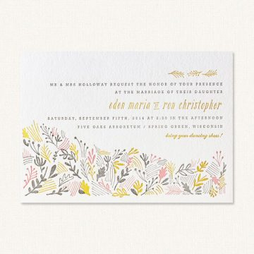 Country themed wedding invitations with letterpress printing and country florals.