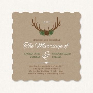 Deer antler wedding invitations with antlers and pine cone.