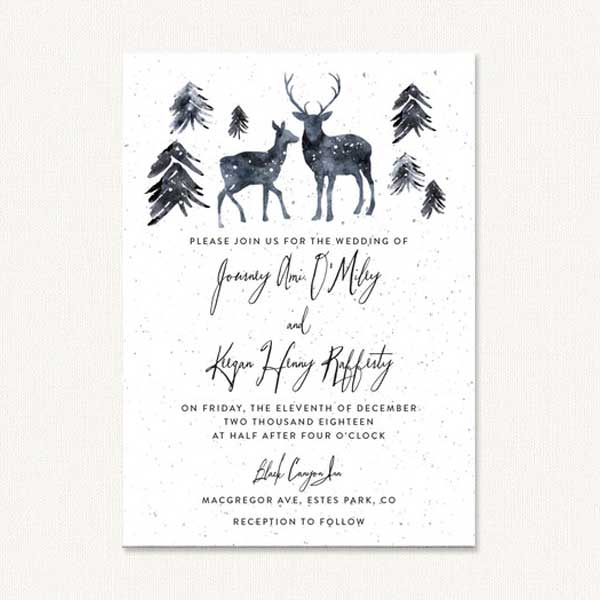 Deer wedding invites with winter deer and pine trees.