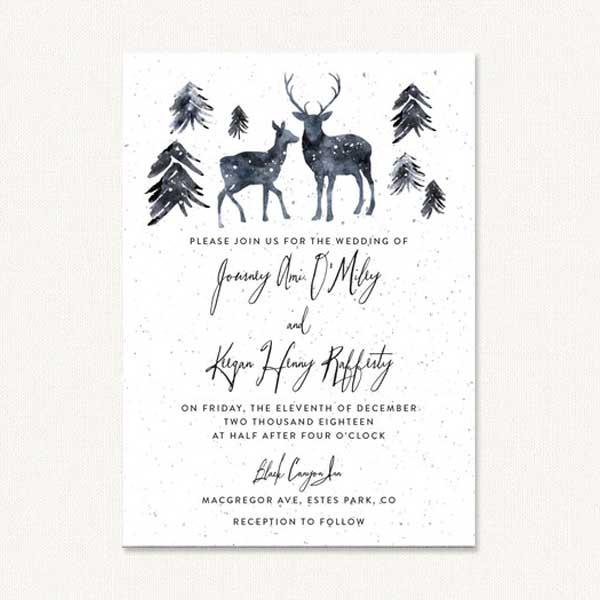 Deer wedding invites with winter deer and pine trees.