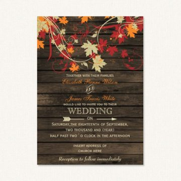 Fall rustic wedding invitations with autumn color leaf flourishes on a barn wood background