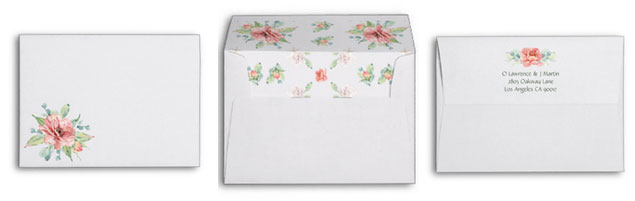 Watercolor flower wedding invitations matching floral envelopes with return address.