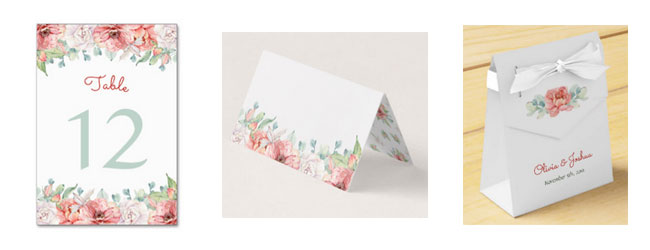 Matching watercolor flower wedding stationery and items.