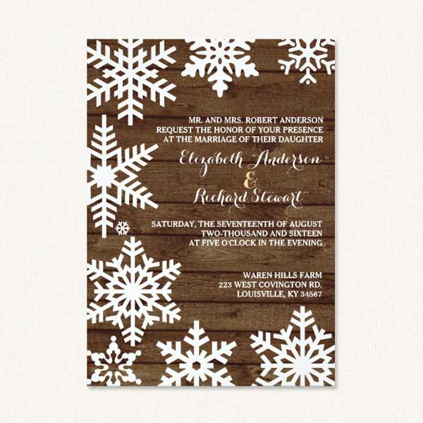 winter barn wedding invitations with white snowflakes rustic wood