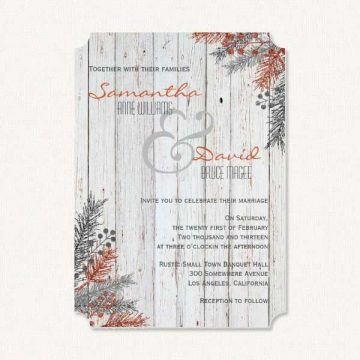 Winter rustic wedding invitations with rustic white washed wood and winter sprigs.