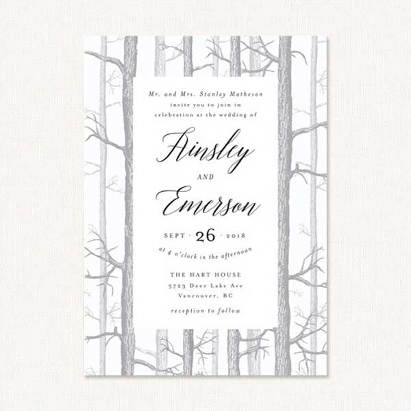 Winter theme wedding invitations with winter birch tree forest.
