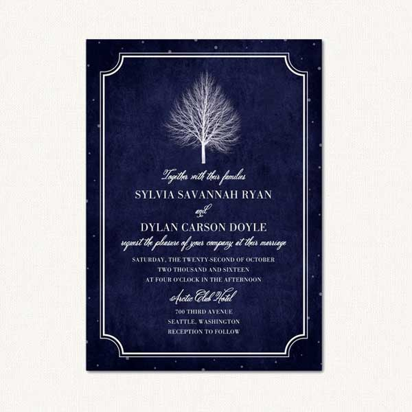 Winter tree wedding invitations with trees covered in delicate snow.