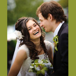 Bride and Groom with green orchid bouquet and buttonhole